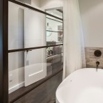 Master Bath Tub at Glass Wall into with Libary Glass Wall behind